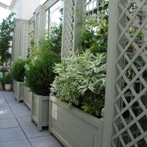 Aluminum treillage and planters on balcony