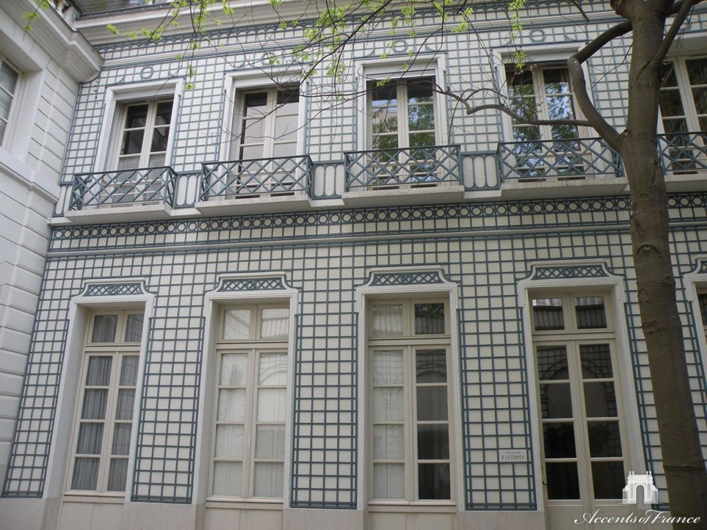 The back facade of a residential property is made more interesting when covered with decorative latticework.