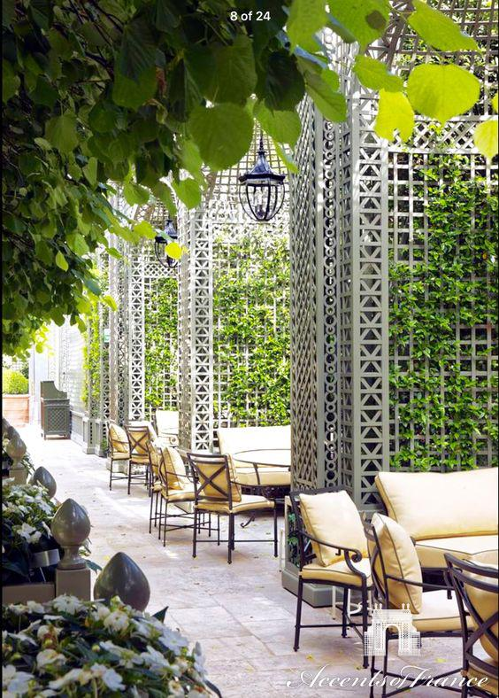 Custom decorative wood treillage with alcoves in the Winter Garden at the Ritz Hotel in Paris. Painted in custom color.