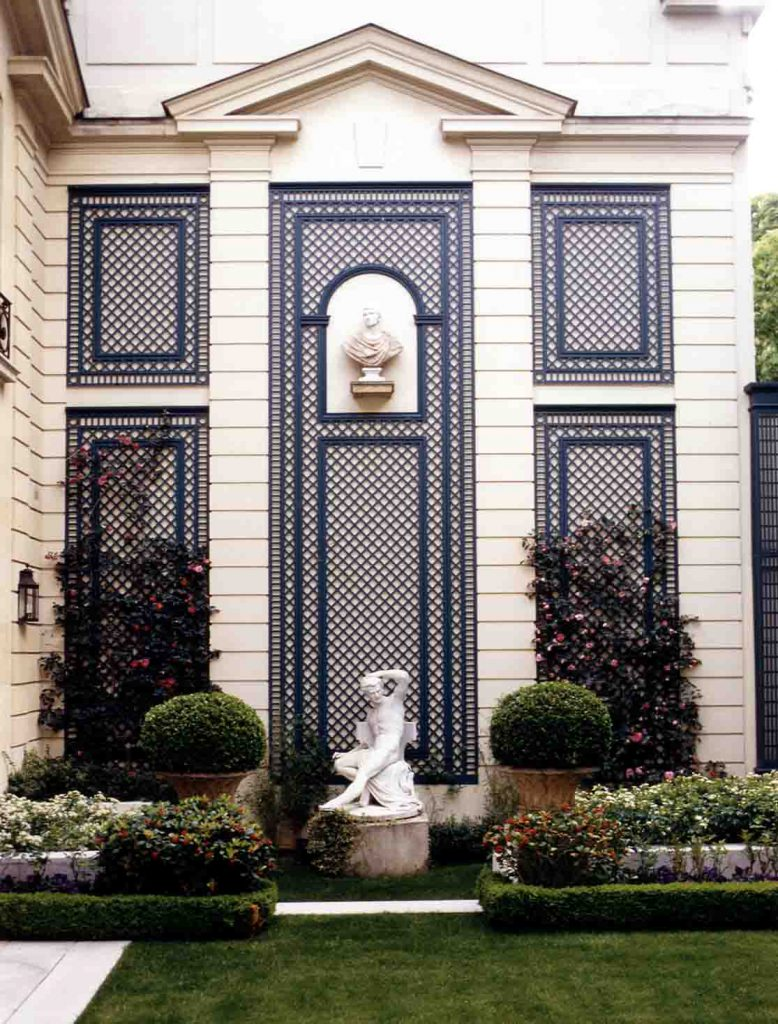 Greater sophistication added to the facade of a building with decorative latticework panels.